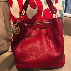 MK red leather bag